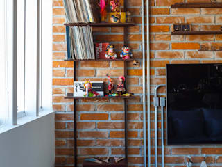 Ruang Keluarga oleh Nautilo Arquitetura & Gerenciamento, Industrial Batu Bata