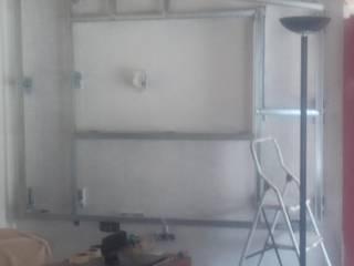 Colocação de estrutura em pladur para encastrar televisão por REMODELAÇÕES E PINTURAS - SÉRGIO SOARES