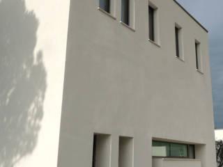 Sopraelevazioni, ampliamenti e restauri di EILAND Minimalista