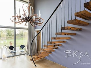 Flamed oka cantilevered staircase :  Stairs by Bisca Staircases
