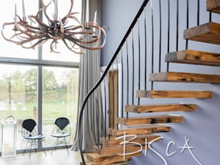 Flamed oak cantilevered staircase Bisca Staircases Scale Legno