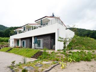 미래촌: 건축사사무소 아키포럼의  주택