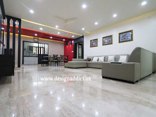 Total Interior design work in Wakad, Pune:  Living room by Designaddict