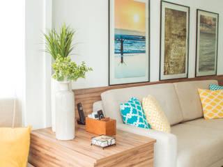 Sala de estar integrada com varanda gourmet.: Salas de estar  por INTERIOR - DECORAÇÃO EMOCIONAL,Moderno