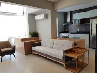 Salones de estilo moderno de ICONO Projetos e Interiores Moderno