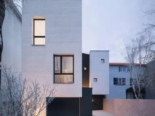 maison contemporaine à Enghien Les Bains: Maison individuelle de style  par Fabrice Commercon