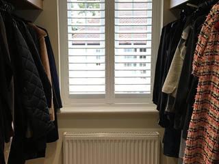 Full Height Shutter in The Cloak Room Plantation Shutters Ltd Ruang Ganti Modern Kayu White