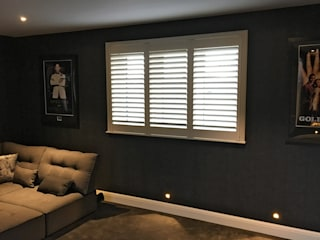 Full Height Shutter in The Cinema Room:  Electronics by Plantation Shutters Ltd