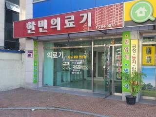식품매장: 디자인K하우징의  주택