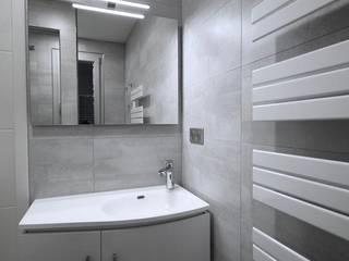 petite pièce, grande douche : Salle de bains de style  par RG Intérieur