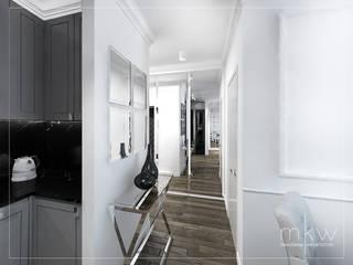 Elegancki Żoliborz: styl , w kategorii Korytarz, przedpokój zaprojektowany przez MKW Pracownia Architektury