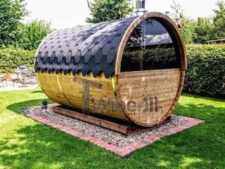 Buitenbad sauna met aanhanger kleedkamer en Harvia oven:   door TimberIN hot tubs en sauna's
