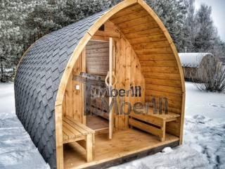 Buiten houten sauna voor tuin igloontwerp:   door TimberIN hot tubs en sauna's