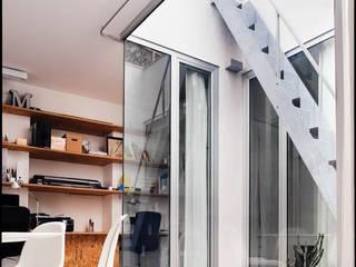 Casa Studio Manuarino Giardino d'inverno minimalista di manuarino architettura design comunicazione Minimalista