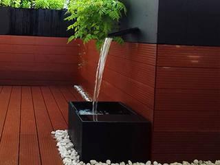 Ático en Madrid con fuente Jardines de estilo moderno de La Habitación Verde Moderno