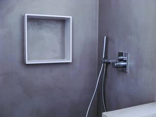 Ducha en microcemento.: Baños de estilo moderno de GPA Gestión de Proyectos Arquitectónicos  ]gpa[®