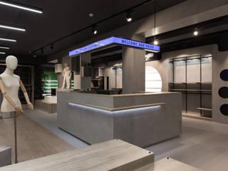 Sport Retail: Espaços comerciais  por Cervus Concept & Retail,Moderno
