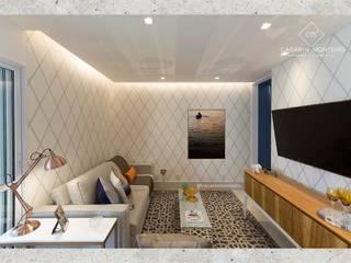 Salas de estilo ecléctico de CASARIN MONTEIRO ARQUITETURA & INTERIORES Ecléctico