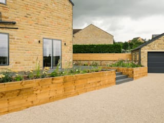 Deck bounded by Raised Sleeper Beds:  Garden by Yorkshire Gardens