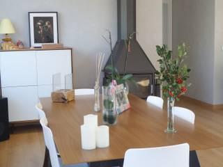 Dining room by MUMARQ ARQUITECTURA E INTERIORISMO, Eclectic