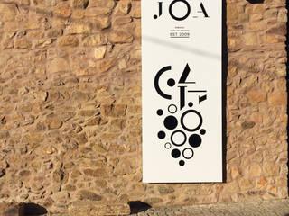 JOA: Lojas e espaços comerciais  por IMARTE, atelier,Industrial