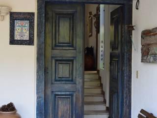 Casa LC: Corredores e halls de entrada  por Patricia Abreu arquitetura e design de interiores,