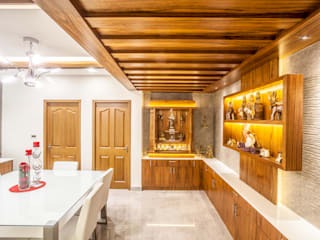 The mural apartment:  Dining room by S Squared Architects Pvt Ltd.