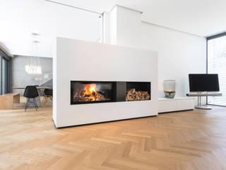Rüegg Kamin NEPTUN: modern  von Rüegg Cheminée Schweiz AG,Modern