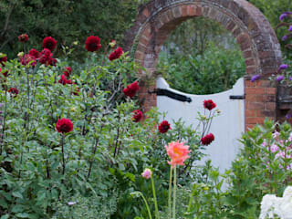 Brick arch with roses Daniel Shea Garden Design Country style gardens