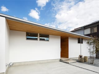 Single family home by 一級建築士事務所haus,