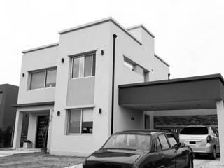 Casa AK: Casas unifamiliares de estilo  por MC Arquitectura