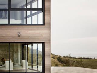 Rénovation d'une grange avec extension par Optiréno Moderne Bois Effet bois