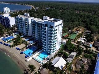 EDIFICIO OCEANÍA COVEÑAS: Casas multifamiliares de estilo  por mínimal arquitectura, Minimalista