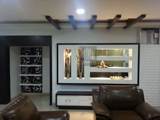 Living room by TRIUMPH INTERIORS