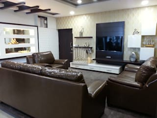 T.V Unit & False Ceiling:   by TRIUMPH INTERIORS