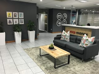 Decorating the Durban branch of Mr Price Money : modern  by Just Interior Design, Modern