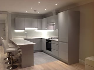 Kitchen layout AFTER with pale grey units:   by The Room Company