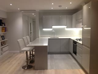 AFTER Shot of open plan kitchen with pocket fire door:   by The Room Company