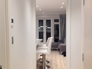 AFTER View to living room from hallway with pocket fire door:   by The Room Company