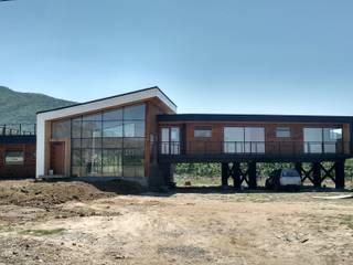 Vivienda Mario Cardemil: Casas de estilo moderno por Kimche Arquitectos