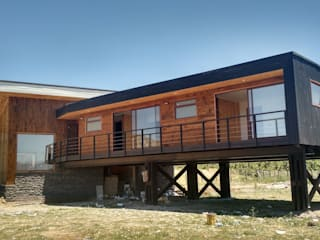 KIMCHE ARQUITECTOS Wooden houses Wood