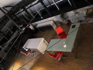Oficinas y Showroom M3 ARQUITECTOS Y PROYECTOS / M3 MOBILI :  de estilo  por M3 ARQUITECTOS - M3 MOBILI