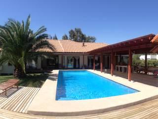 Vista desde la Piscina, : Casas de madera de estilo  por Casabella