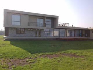 CASA LAMPA : Casas unifamiliares de estilo  por Incubar: Arquitectura & Construcción