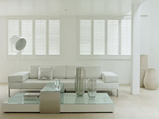 Basswood shutters:   by Harvey Bruce Blinds, Shutters & Interiors