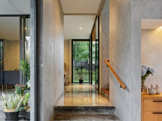 Tamara Wibowo Architects Tropical style corridor, hallway & stairs Concrete