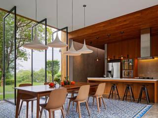 Tamara Wibowo Architects Tropical style kitchen Wood