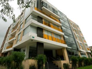 Edificio C57: Paredes de estilo  por RIVAL Arquitectos  S.A.S.