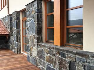 Natursteinfassade - Massive Rock Rustikale Häuser von Tschechische Steinmetze Rustikal