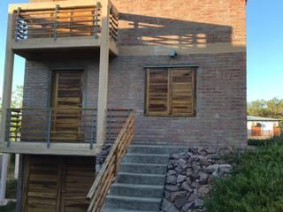 Casa de playa en Monte Hermoso de Inca Arquitectura Rústico